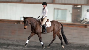 Stephanie and True Bellamy Stephanie Pictured Wearing the Asmar Equestrian Compression top